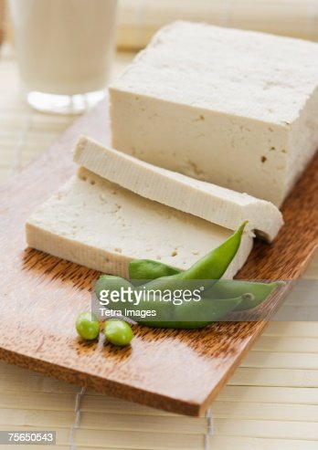 Soybeans and sliced tofu on table