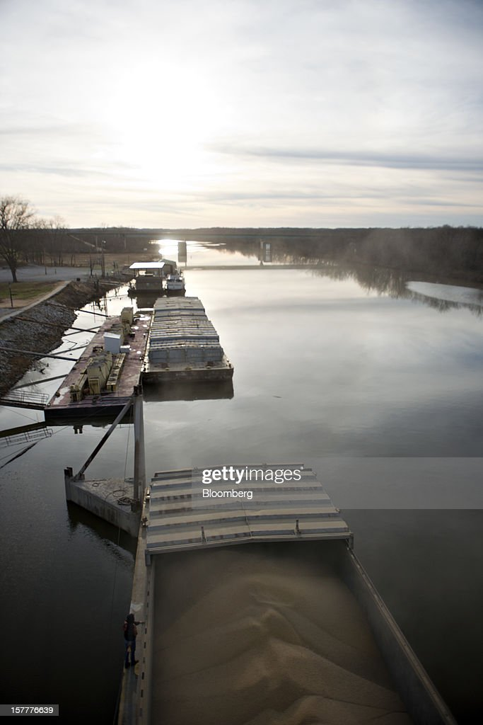Soybeans sit in a barge on the Kaskaskia River, a tributary of the Mississippi River, at Gateway FS in Evansville, Illinois, U.S., on Wednesday, Dec. 5, 2012. U.S. farmers, facing aftershocks of the worst drought in 50 years, are improvising alternative plans for corn, soybeans and other grains that won't be moving to world markets as the Mississippi River dries up. Photographer: Daniel Acker/Bloomberg via Getty Images