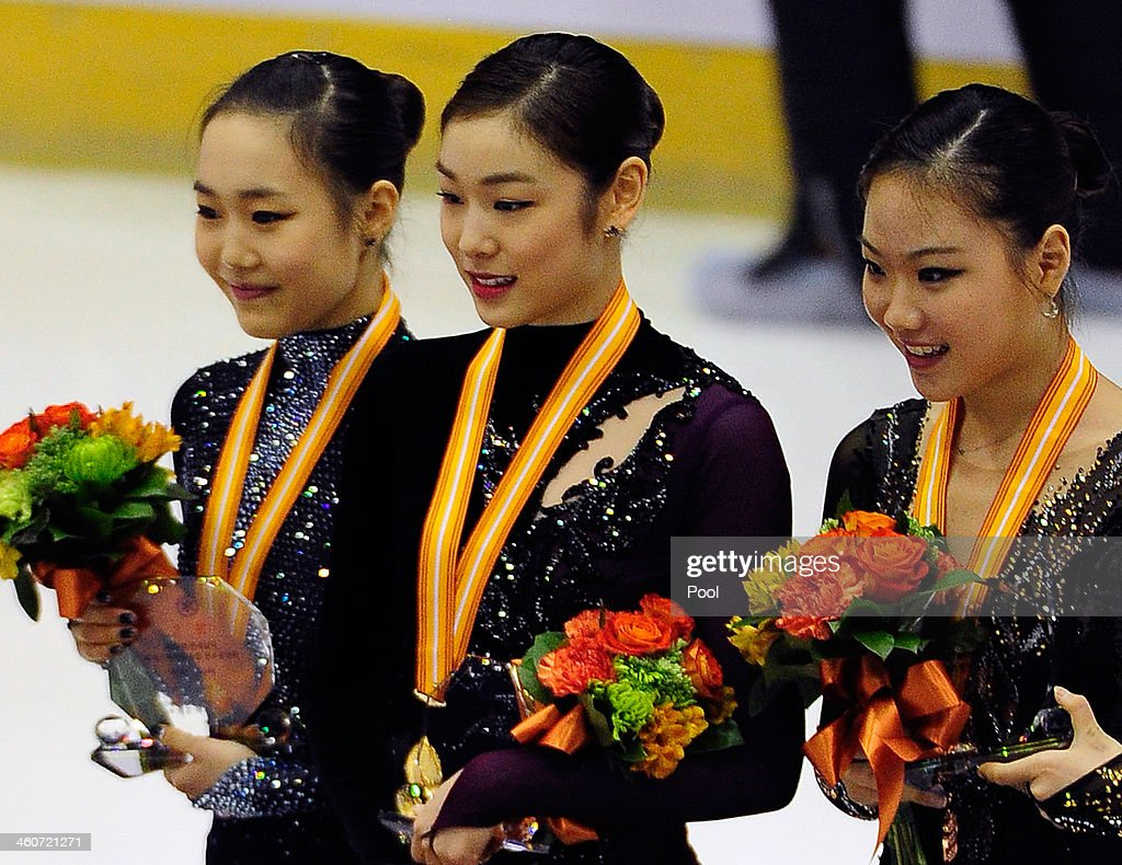 So-Yeon Park (2nd), Yuna Kim (1st) and Hae-Jin Kim (3rd) of South Korea celebrate during the Medal Ceremony for the Ladies Free Skating program during the Korea Figure Skating Championships 2014 at Goyang Oulimnuri Ice Rink on January 5, 2014 in Goyang, South Korea.