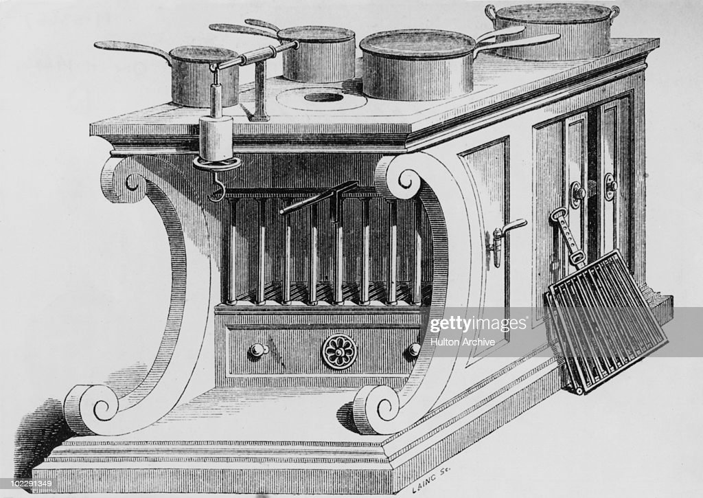 Soyer's Modern Housewife's Kitchen Apparatus, circa 1850. The invention of French chef Alexis Soyer, it boasts an open roasting fire, a hot water boiler, a baking oven, a broiling stone and a hot plate. An engraving by Laing.