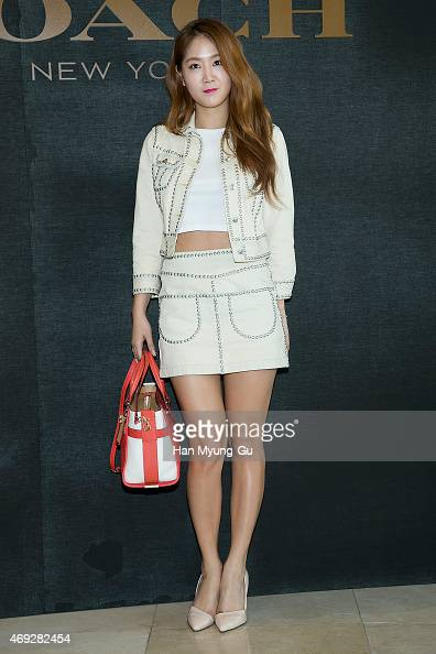 Soyou of South Korean girl group SISTAR attends the renewal opening for the COACH at Lotte Department Store on April 10 2015 in Seoul South Korea