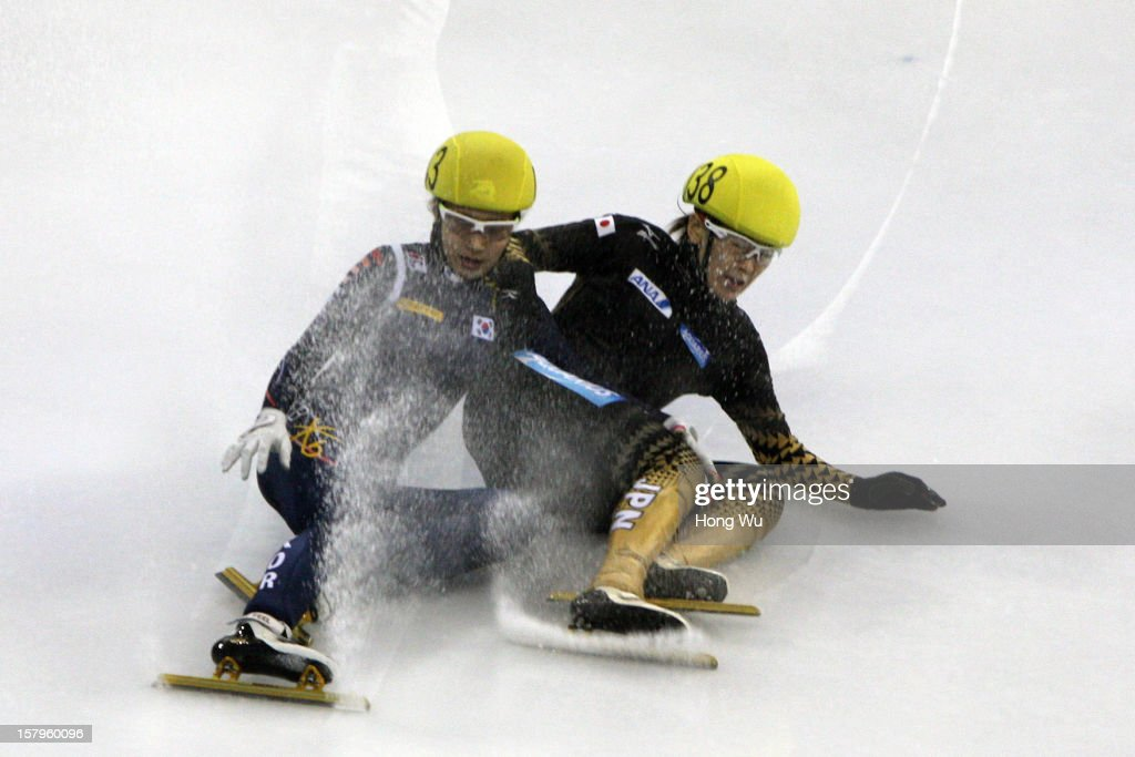 Soyoun Lee of Korea (L) and Sayuri Shimizu of Japan fall down in the Women's 1000m Quarter final during the day one of the ISU World Cup Short Track at the Oriental Sports Center on December 8, 2012 in Shanghai, China.