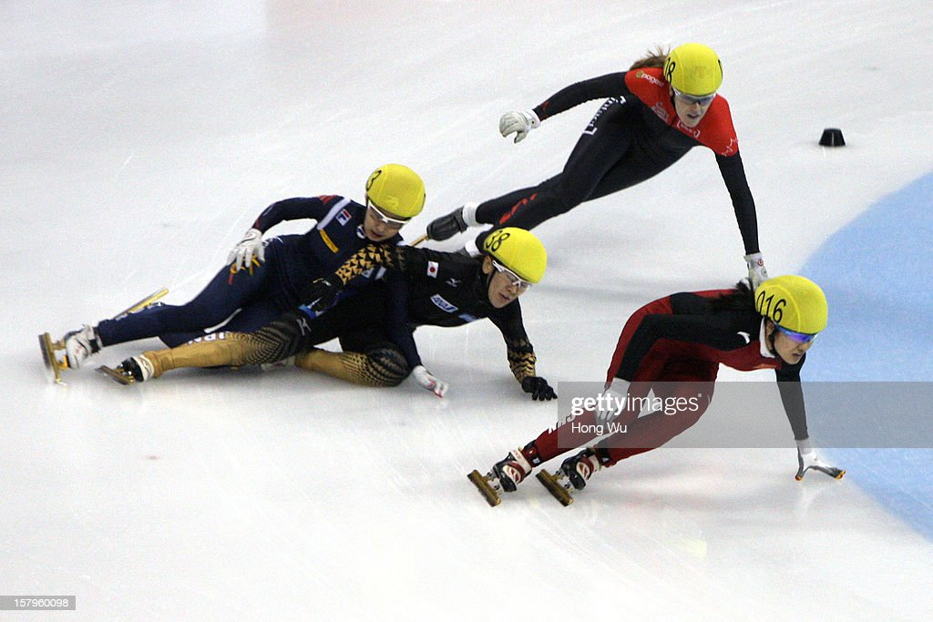 Soyoun Lee of Korea, Sayuri Shimizu of Japan fall down as they compete with Jessica Gregg of Canada and Qiuhong Liu of China in the Women's 1000m Quarter final during the day one of the ISU World Cup Short Track at the Oriental Sports Center on December 8, 2012 in Shanghai, China.