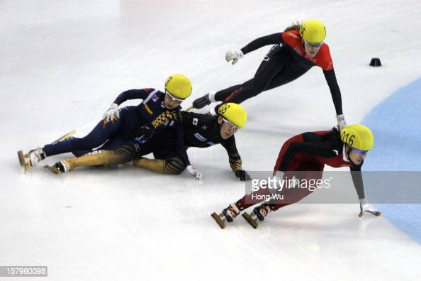 Soyoun Lee of Korea Sayuri Shimizu of Japan fall down as they compete with Jessica Gregg of Canada and Qiuhong Liu of China in the Women's 1000m...