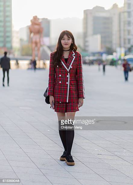Soyoung Sim wearing a plaid jacket and shorts and overknee socks and Puma sneaker on October 18 2016 in Seoul South Korea