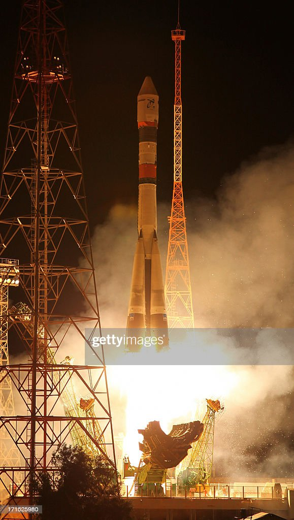 A Soyuz-2 rocket carrying a Resurs-P satellite blasts off from a launch pad in the Russian leased Kazakhstan's Baikonur cosmodrome late on June 25 , 2013. The Russian carrier rocket successfully placed on the target orbit the first Resurs-P Earth imaging satellite, the RIA-Novosti news agency reported.