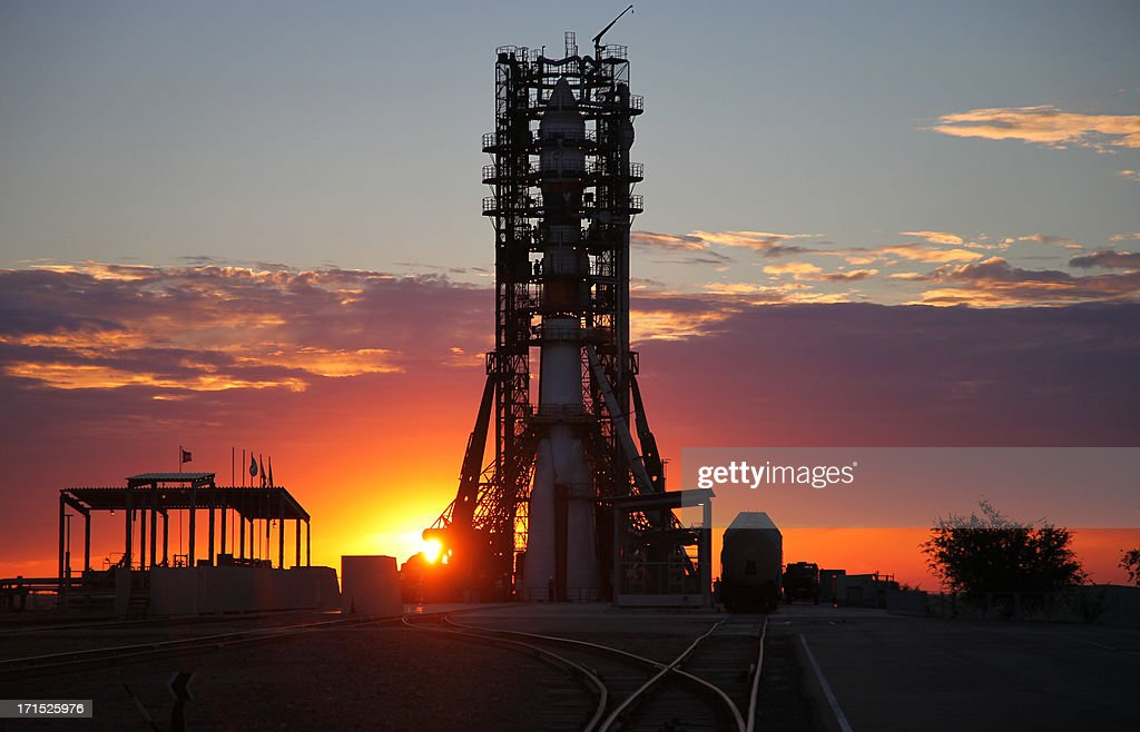 A Soyuz-2 rocket carrying a Resurs-P satellite rises at a launch pad in the Russian leased Kazakhstan's Baikonur cosmodrome late on June 25 , 2013. The Russian carrier rocket successfully placed on the target orbit the first Resurs-P Earth imaging satellite, the RIA-Novosti news agency reported.