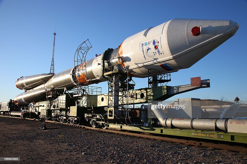 A Soyuz-2.1b carrier rocket, carrying a Bion-M satellite is transported to a launch pad in the Russian leased Kazakhstan's Baikonur cosmodrome on April 18, 2013. Bion-M, part of the Russia's space program, is to conduct fundamental and applied research in space biology, physiology and biotechnology while in orbit, RIA-Novosti news agency reported. AFP PHOTO