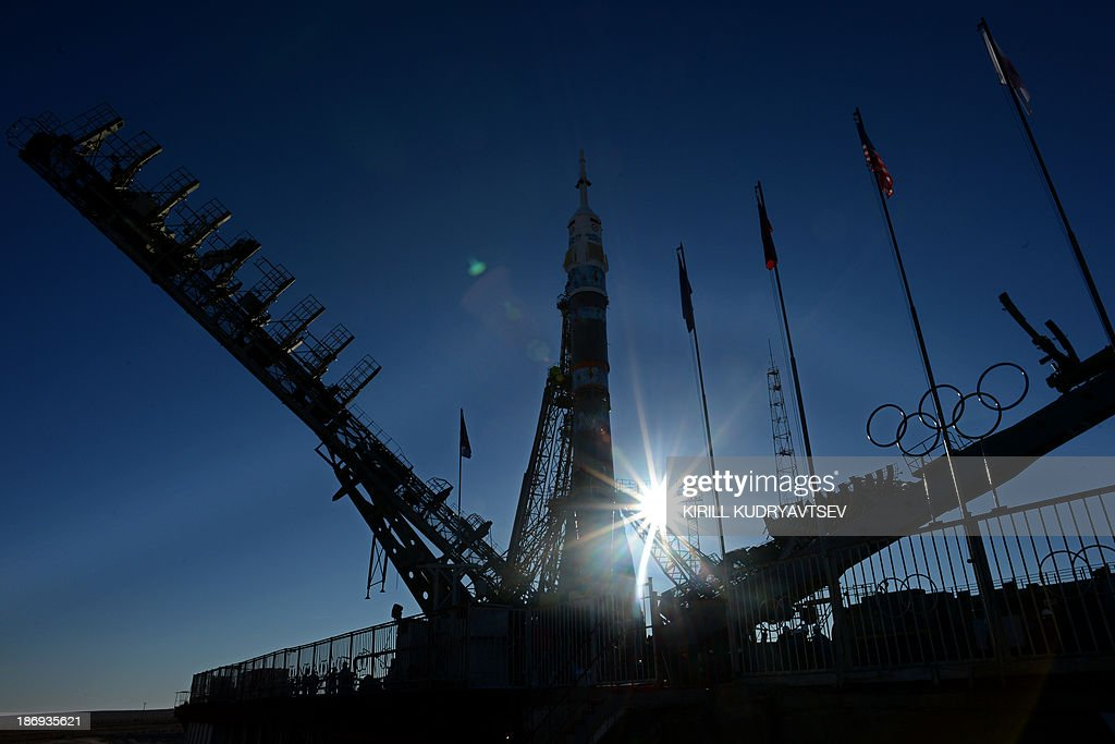 Soyuz-FG launch vehicle with Soyuz TMA-11M spacecraft of the International Space Station (ISS) Expedition 39 aboard rises at a launch pad in the Russian-leased Baikonur cosmodrome in Kazakhstan, on November 5, 2013. The Soyuz TMA-11M with an international crew, including Japanese astronaut Koichi Wakata, Russian cosmonaut Mikhail Tyurin and US astronaut Rick Mastracchio, and with an unlit torch of Sochi 2014 Winter Olympic aboard is scheduled to blast off to the ISS from Baikonur on November 7. The torch is scheduled to return back to Earth on November 11.