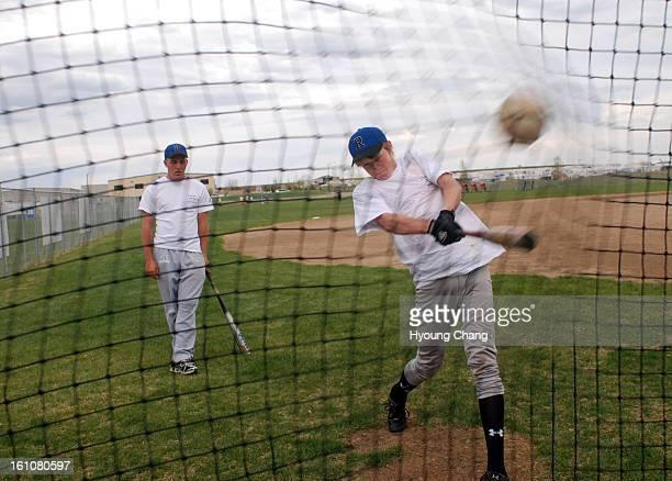 sp08prpresurection Batting coach Steven Ortner left is checking the batting of Ethan Bowlin during Resurrection Christian High School baseball team...