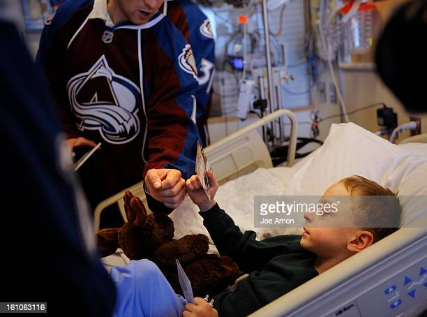 sp19avschildren11b Colorado Avalanche defensemen JohnMichael Liles cracks knuckles with 7 year old Andrew Stinson of Loveland while the team made its...