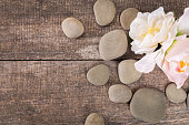 spa background with zen stones on wooden table