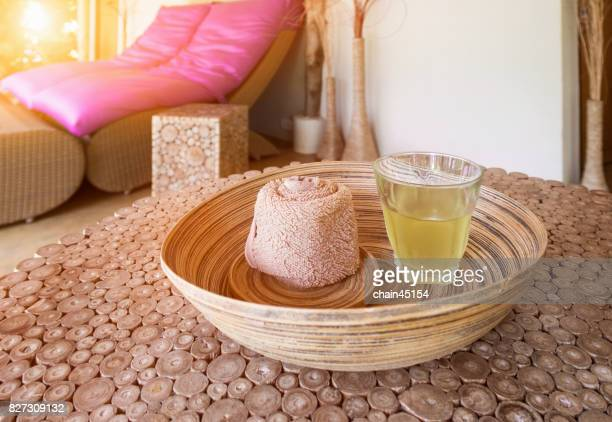 Spa cosmetic products concept, spa background with Beautiful composition of spa treatment and drinking herb on wooden table.