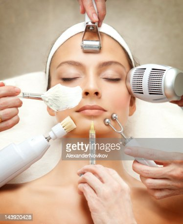 Spa Salon: Young Beautiful Woman Having Various Facial Treatment.