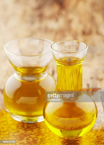 Spa still life of massage oil in two glass vessels