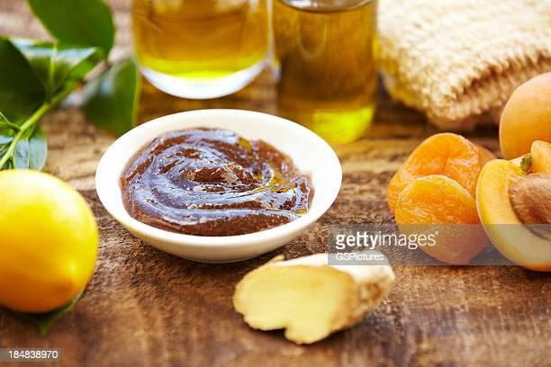 Spa still life of organic skincare, salt scrub, apricots