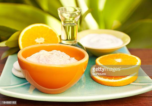 Spa still life with facial mask, oil massage, oranges
