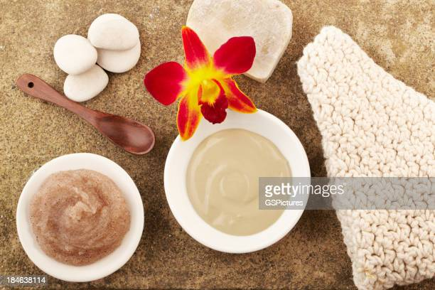 Spa still life with mud mask and salt scrub