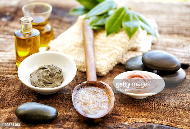 Spa still life with mud mask, salt scrubbing, massage oil