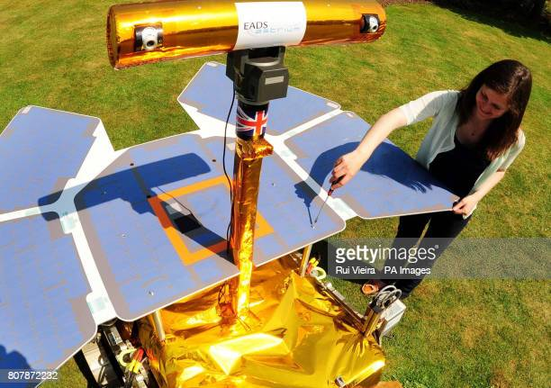 Space craft engineer Jessica Housden makes adjustments to a development model of the Mars Rover called Bridget at the University of Leicester as she...