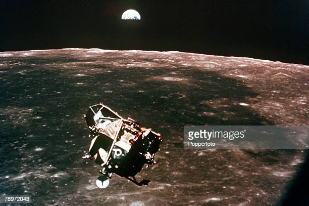 circa 20th July 1969 The lunar module the moon and the earth photographed by astronaut Michael Collins from the command module Apollo 11 with it's...