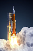 Space Launch System Takes Off On Blue Background. 3D Illustration. NASA Images Not Used.