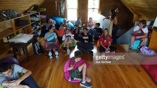 Space of Mind School students gather for morning meditation Wednesday Oct 4 in the old home that serves as the school