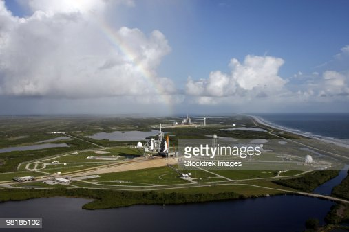 Space Shuttle Atlantis and Endeavour sit on their launch pads at Kennedy Space Center.
