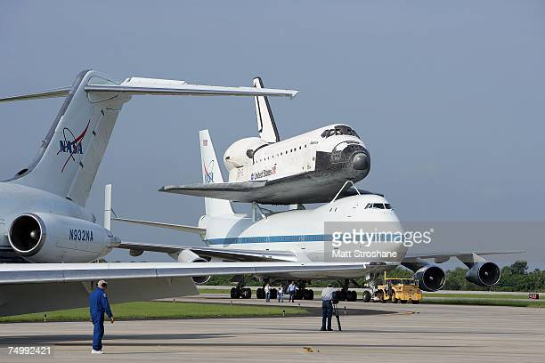 Space Shuttle Atlantis atop a modified Boeing 747 is towed at the Kennedy Space Center July 3 2007 in Cape Canaveral Florida Atlantis having...