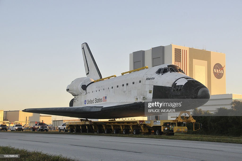 US Space Shuttle Atlantis begins its final move on November 2, 2012 as crews move it from its temporary parking in the Vehicle Assembly Building at Kennedy Space Center in Cape Canaveral, Florida, to the Center's Visitor Center for permanent display. The spacecraft traveled 125,935,769 miles(202,673,974kms) during 33 spaceflights, including 12 missions to the International Space Station. Its final mission, STS-135, closed out the Space Shuttle Program era with a landing on July 21, 2011. AFP PHOTO/Bruce Weaver