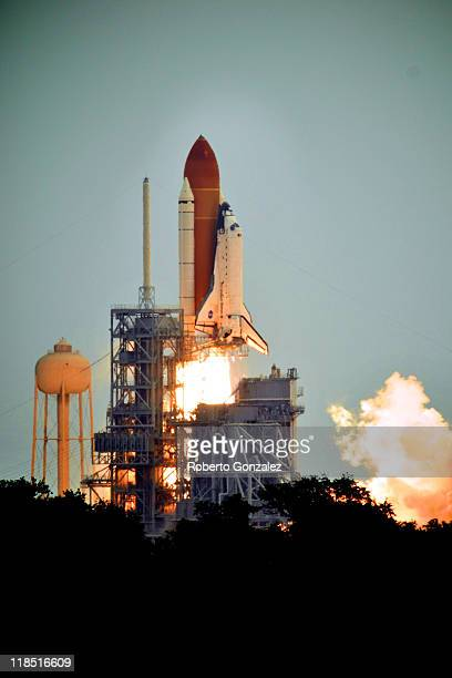 Space shuttle Atlantis blasts off from launch pad 39A at Kennedy Space Center July 8 2011 in Cape Canaveral Florida This liftoff is the last in the...