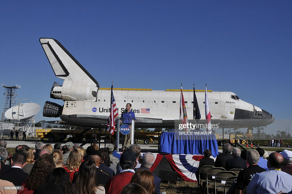 US Space Shuttle Atlantis final mission commander Chris Ferguson speaks on November 2, 2012 as crews move Atlantis to the Visitor Center of the Kennedy Space Center in Cape Canaveral, Florida, for permanent display. The spacecraft traveled 125,935,769 miles(202,673,974kms) during 33 spaceflights, including 12 missions to the International Space Station. Its final mission, STS-135, closed out the Space Shuttle Program era with a landing on July 21, 2011. AFP PHOTO/Bruce Weaver