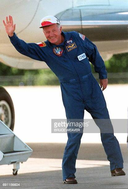 US Space Shuttle Atlantis French crew member JeanLoup Chretien waves to his wife 22 September upon his arrival at Kennedy Space Center in Florida to...
