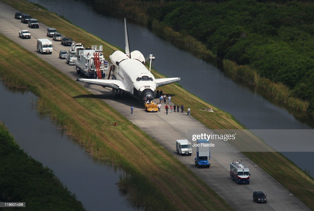 Space Shuttle Atlantis is towed at Kennedy Space Center July 21 2011 in Cape Canaveral Florida Atlantis was the final shuttle mission for NASA ending...