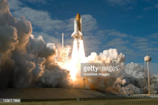 Space Shuttle Atlantis lifts off from its launch pad at Kennedy Space Center, Florida.