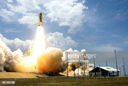 Space Shuttle Atlantis lifts off from its launch pad.