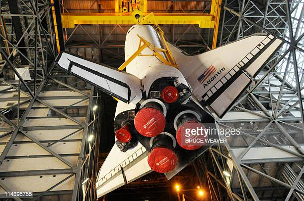 US space shuttle Atlantis on May 18 2011 is lifted in the Vehicle Assembly Building at Kennedy Space Center Florida for the mate to her solid rocket...