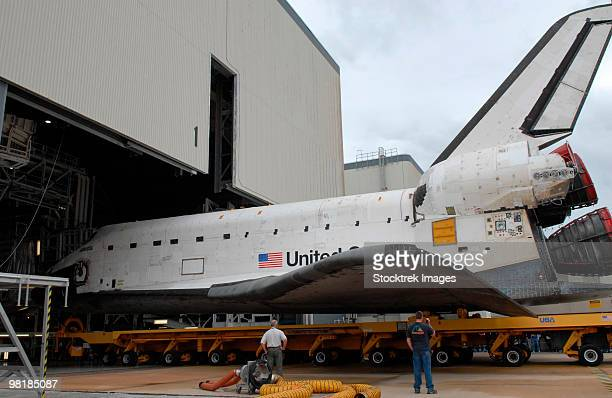 Space shuttle Atlantis rolls out of Orbiter Processing Facility 1 at Kennedy Space Center.