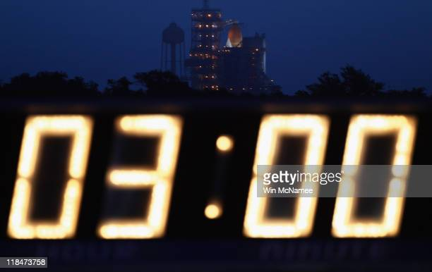 Space shuttle Atlantis sits on the launchpad at dawn as the countdown clock holds at three hours at the Kennedy Space Center July 8 2011 in Cape...