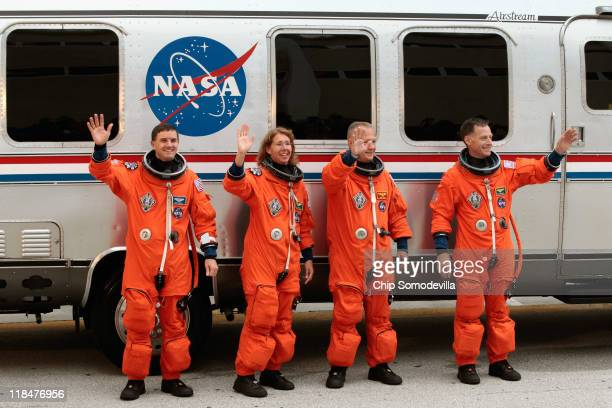Space shuttle Atlantis STS135 mission specialists Rex Walheim and Sandra Magnus pilot Douglas Hurley and commander Christopher Ferguson stop and pose...