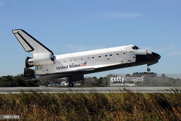 Space shuttle Atlantis touches down at Kennedy Space Center, Florida.