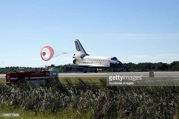Space shuttle Atlantis unfurls its drag chute upon landing at Kennedy Space Center, Florida.
