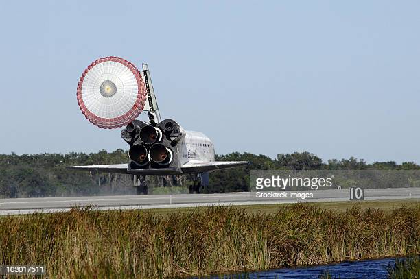 Space shuttle Atlantis unfurls its drag chute upon landing at Kennedy Space Center, Florida.