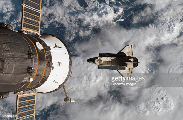 Space Shuttle Atlantis with the Soyuz spacecraft visible at left.