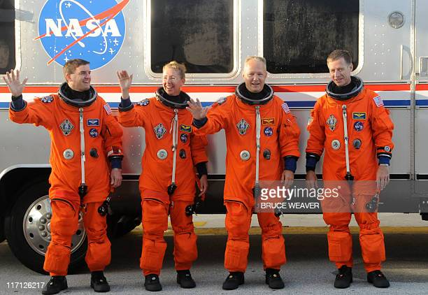 US space shuttle Atlantis's crew Rex Walheim Sandy Magnus Pilot Doug Hurley and Commander Chris Ferguson on June 23 2011 pause for a photo as they...