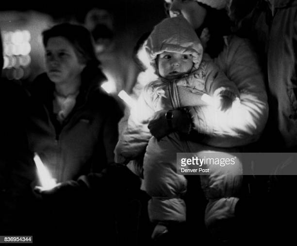 Space Shuttle Challenger Candle light service in Civic Center Johnny Ziglur Zigler age 7 months was one of the attendees at the candle light memorial...