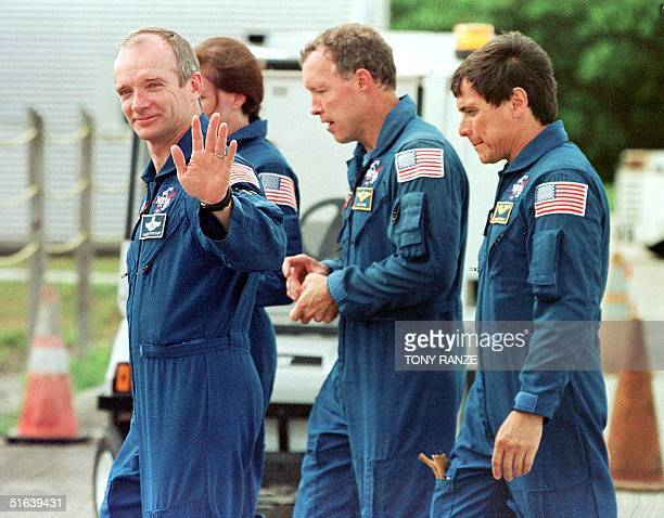 nasa announced onboarding of john glenn in the space shuttle discovery In the launch pad's white room, sts-95 payload specialist john h  climbing  into space shuttle discovery for his second flight into space,.