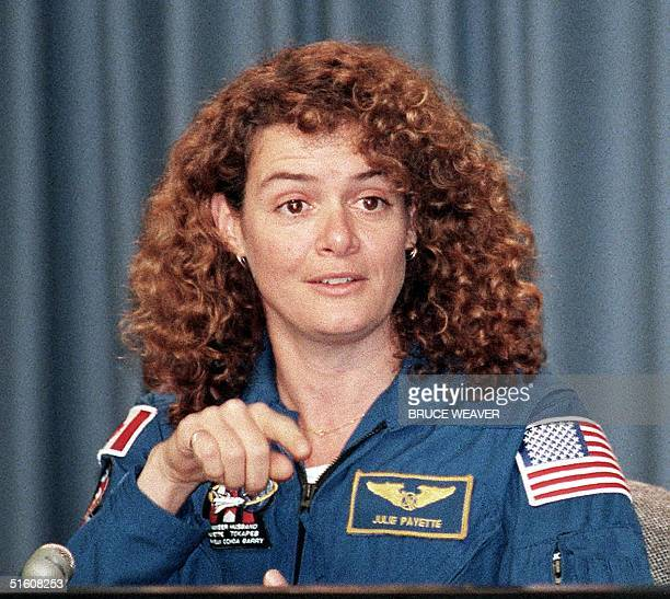 US space shuttle Discovery crew member Julie Payette of Canada takes a question during a press conference 07 June 1999 at Kennedy Space Center...
