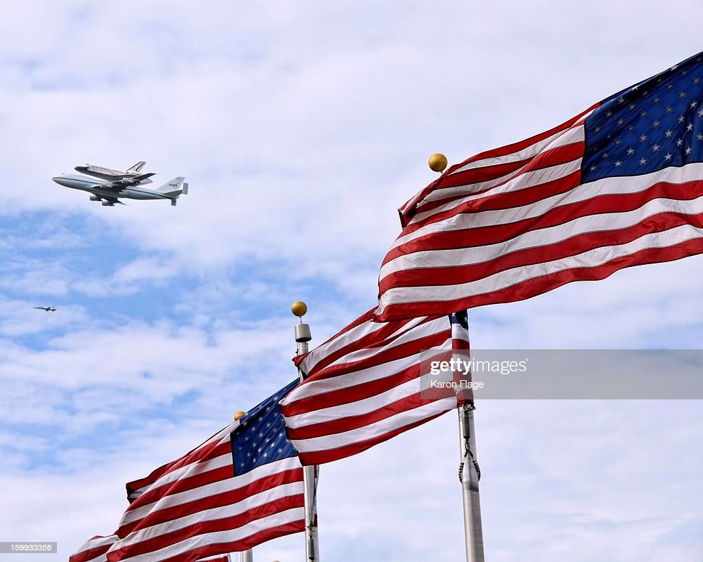 CONTENT] Space Shuttle Discovery is seen in a flyover of the Washington Monument flag ring in Washington, DC.