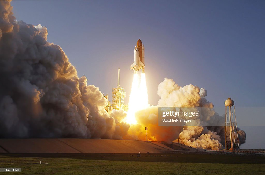 Space Shuttle Discovery lifts off from its launch pad at Kennedy Space Center, Florida.